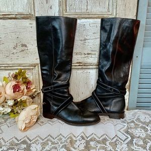 Tall black leather riding boots